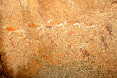 Rock paintings, like this undated example of human figures and antelopes by the San in Namibia, southern Africa, provide rare graphic evidence of earlier hunter-gatherer life. Rock art exists throughout the world but is difficult to date. The oldest dated example, found in Australia, is believed to be 28,000 years old.