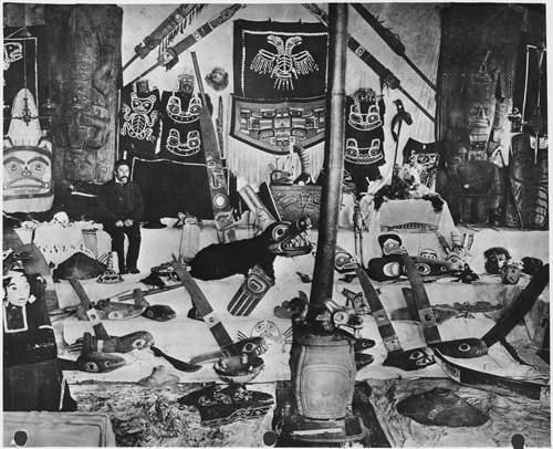 Tlingit Chief Charles Jones Shakes, pictured at home in Wrangell, Alaska, with an array of his possessions, ca. 1907. The Tlingit, a society dependent on fishing, exemplify the hierarchical structure of complex hunter-gatherer societies