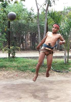 A boy playing ulama, a modern version of the Mesoamerican ballgame, in Sinaloa, Mexico.